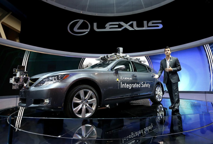 LAS VEGAS, NV - JANUARY 08: A Lexus LS Integrated Safety self-driving car is displayed at the Lexus booth during the 2013 International CES at the Las Vegas Convention Center on January 8, 2013 in Las Vegas, Nevada. CES, the world's largest annual consumer technology trade show, runs from January 8-11 and is expected to feature 3,100 exhibitors showing off their latest products and services to about 150,000 attendees. (Photo by Justin Sullivan/Getty Images)