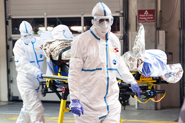 Geneva University Hospital, Cuban doctor Felix Baez Sarria who contracted Ebola in Sierra Leone arrives on a gurney at the Geneva University Hospital in Geneva Switzerland Friday Nov. 21 2014. Baez a member of