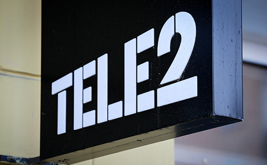 A Tele2 logo sits on display outside a Tele2 Russia Holding AB retail store in Nizhny Novgorod Russia on Friday Nov. 1 2013. President Vladimir Putin's billionaire ally Yury Kovalchuk is buying half of Tele2 with partners seeking to make the wir
